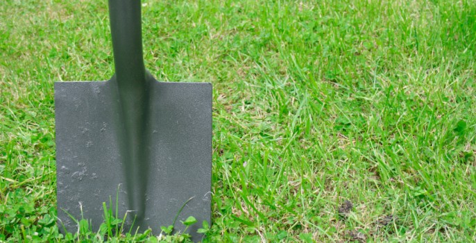 Shovel In Grass For Breaking Ground